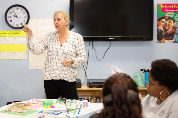 early ed instructor teaching oral health class to teachers